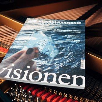 Magazin »Visionen« liegt auf einem Flügel